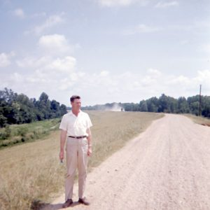 man beside gravel road